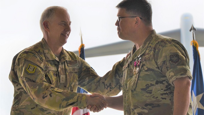 U.S. Air Force Expeditionary Center commander met with 627th Air Base Group Airmen, presents Legion of Merit to outgoing commander